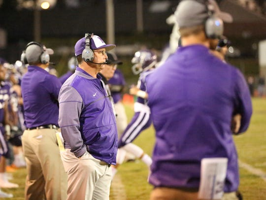Milan coach Jeff Morris looks onto the field as his