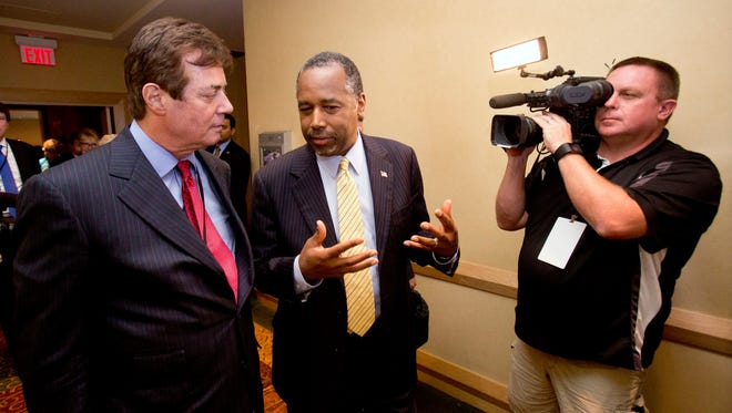 Paul J. Manafort, left, chats with former presidential candidate Ben Carson as they head to a reception at the Republican National Committee Spring Meeting in Hollywood, Fla., on April 21, 2016.
