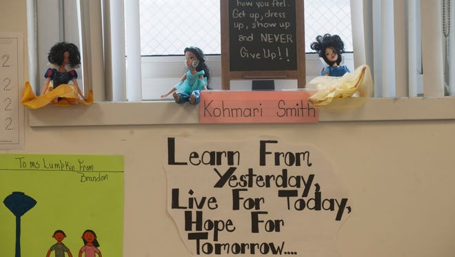 Inspirational quotes are posted in a special needs classroom at Brimm Medical Arts High School, a magnet school in Camden.