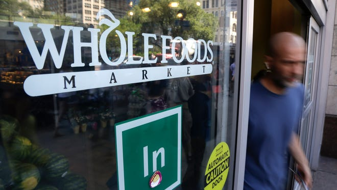 Whole Foods said Monday that it's cutting 1,500 jobs in order to focus more on lowering prices in stores and upgrading technology.