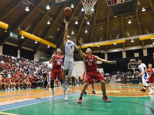 In this March 9, 2018, file photo, the St. Paul Warriors met the St. John's Knights for the IIAAG boys basketball championship game at the University of Guam Calvo Field House.