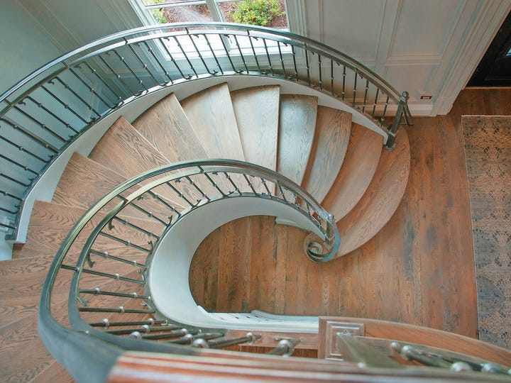 Staircases, while utilitarian, offer an abundance of decorating opportunities.