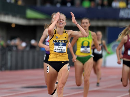 Karissa Schweizer of Missouri celebrates after winning the 5,000 in 15:41.58. It was her final race as a collegian.