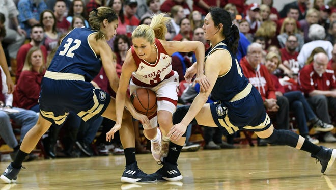 Indiana Hoosiers guard Tyra Buss (3) tries to dribble through a double team during the game against UC Davis at Simon Skjodt Assembly Hall in Bloomington, Ind., on Sunday, March 25, 2018.