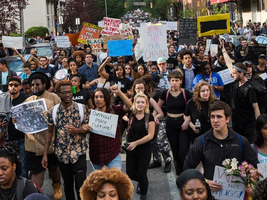 Protesters march chanting 'Justice for Freddie Gray'