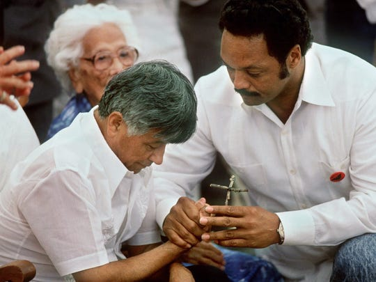Cesar Chavez, then 61, gives a crucifix to Jesse Jackson on Sunday, Aug. 21, 1988, at Chavez's Forty Acres United Farm Worker compound in Delano, Calif., during a 36-day fast.