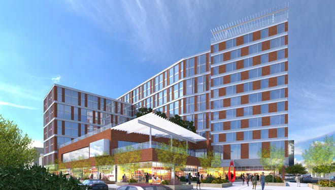A rendering of the 12-story hotel and luxury apartment complex planned on the corner of Grand River Avenue and Abbot Road in East Lansing.