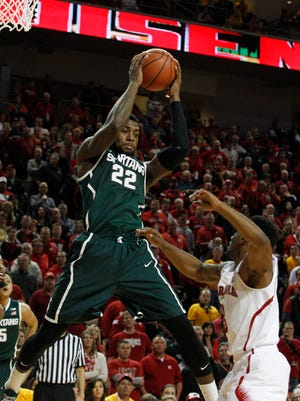 Michigan State guard Branden Dawson grabs the rebound in front of Nebraska guard Benny Parker (3) and guard Terran Petteway (5) in the second half at Pinnacle Bank Arena on Saturday.