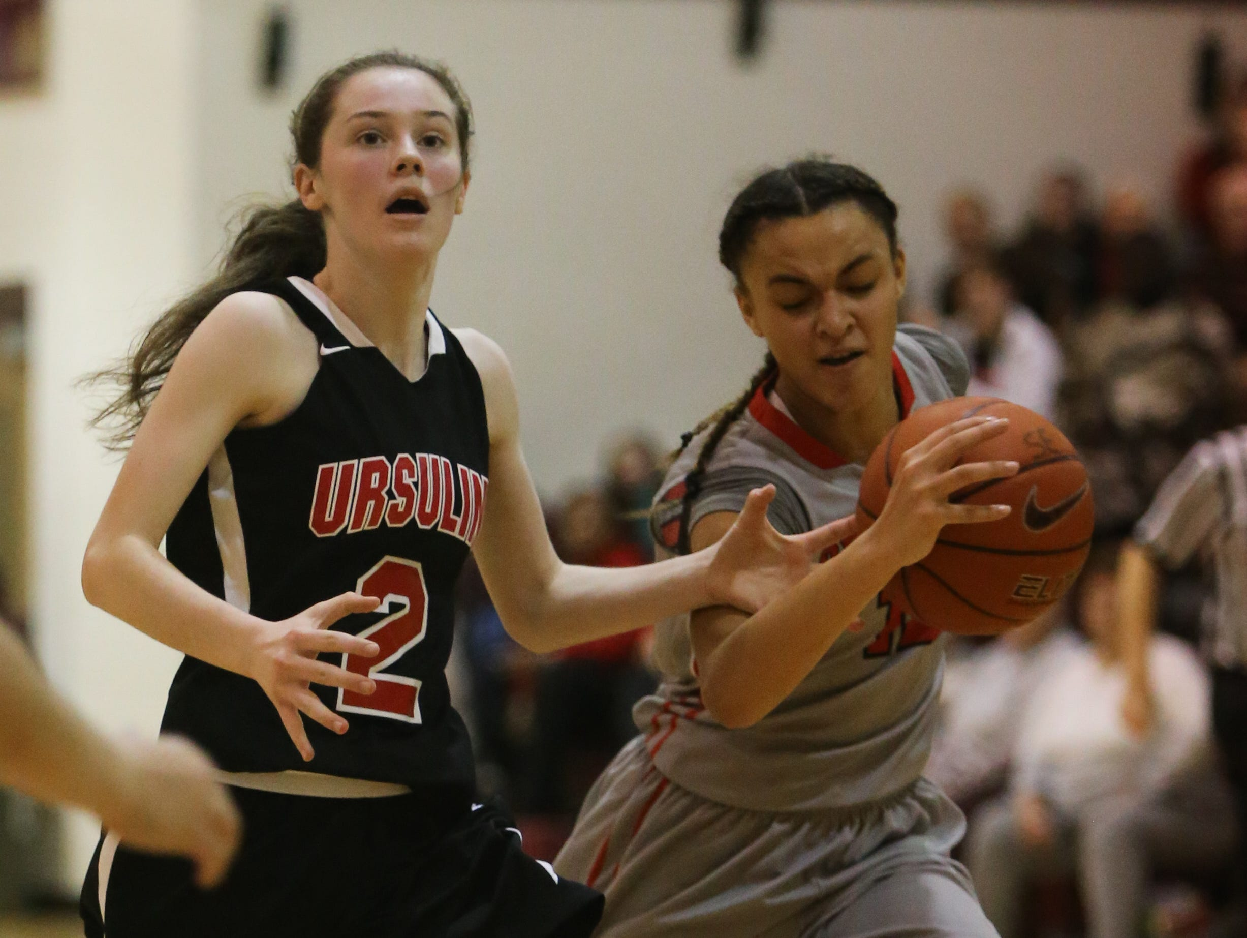 Long Island Lutheran guard Celeste Taylor steals the ball from Ursuline guard Maggie Connolly in the third quarter. Ursuline falls to Long Island Lutheran 52-55 in the semifinals of the Saint Francis Healthcare Cup of the Diamond State Classic at St. Elizabeth High School Tuesday.