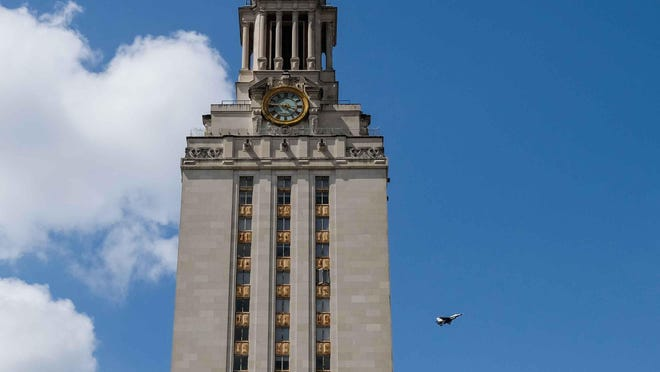 The Thunderbirds fly over the University of Texas Tower in May in a salute to first responders during the COVID-19 pandemic. According to a report from The New York Times, UT has the highest number of coronavirus cases of all universities surveyed by the publication.
