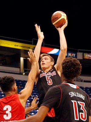 Louisville center Matz Stockman puts up a shot over a defender during the Cardinals' game in Puerto Rico on Wednesday evening.