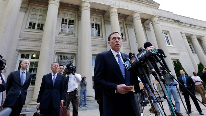 Former CIA director David Petraeus speaks to the media as he leaves the federal courthouse in Charlotte, N.C., Thursday, April 23, 2015 after pleading guilty to sharing top government secrets with his biographer. Petraeus, whose career was destroyed by an extramarital affair with his biographer, was sentenced Thursday to two years' probation and fined $100,000 for giving her classified material while she was working on the book. (AP Photo/Chuck Burton)