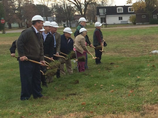 Local and state officials take part in a groundbreaking ceremony at the future home of Interfaith Food Pantry of Portage County in the village of Plover on Monday, Oct. 26, 2015.