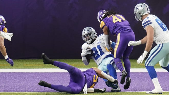 Dallas Cowboys running back Ezekiel Elliott scores on a 6-yard touchdown run over Minnesota Vikings linebacker Eric Kendricks during the first half on Sunday in Minneapolis. Elliott recorded his first 100-yard game in Week 11 and looks to stay hot against Washington.