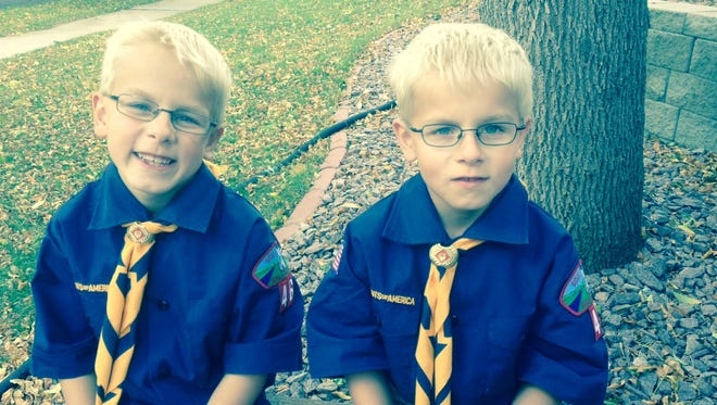 Ian (left) and Hayden Klinski joined Cub Scouts last month and just started selling popcorn.