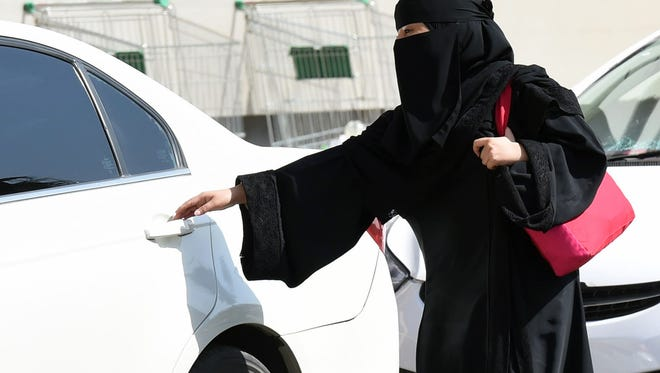This file photo taken on October 26, 2014 shows a Saudi woman getting into a taxi at a mall in Riyadh.