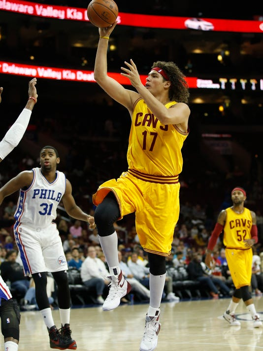 FILe - In this Oct. 8, 2015, file photo, Cleveland Cavaliers' Anderson Varejao shoots during an NBA preseason basketball game against the Philadelphia 76ers, in Philadelphia. Two people with knowledge of the deal say the Cavaliers have acquired forward Channing Frye from the Orlando Magic in a trade for popular center Anderson Varejao. The Cavs will send Varejao to Portland in the trade to acquire Frye, said the people who spoke Thursday, Feb. 18, 2016, to the Associated Press on condition of anonymity because the teams are awaiting league approval. (AP Photo/Matt Slocum, File)