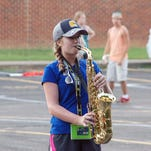 Allison Phillips summons up some sizzle from her alto saxophone.