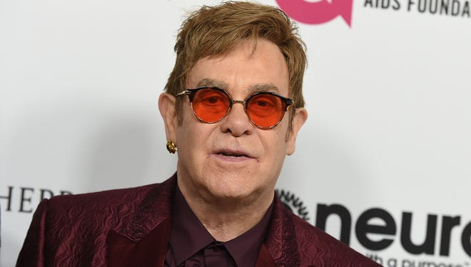 Elton John arrives at Elton John's 70th Birthday and 50-Year Songwriting Partnership with Bernie Taupin celebration in Los Angeles on March 25, 2017.