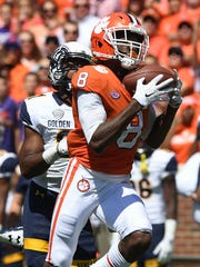 Clemson wide receiver Deon Cain (8) catches a 61 yard