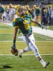 Mayfield Trojans running back Isaac Vance finishes