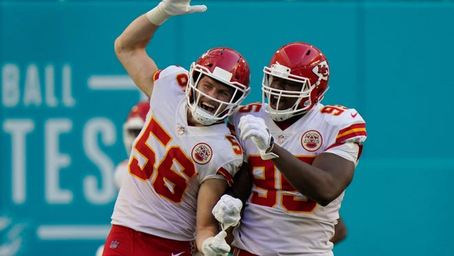 Kansas City Chiefs  linebacker Ben Niemann (56) and defensive tackle Chris Jones (95) celebrate after Jones sacked Miami Dolphins quarterback Tua Tagovailoa in the end zone for a safety, during Sunday's game in Miami Gardens, Fla.
