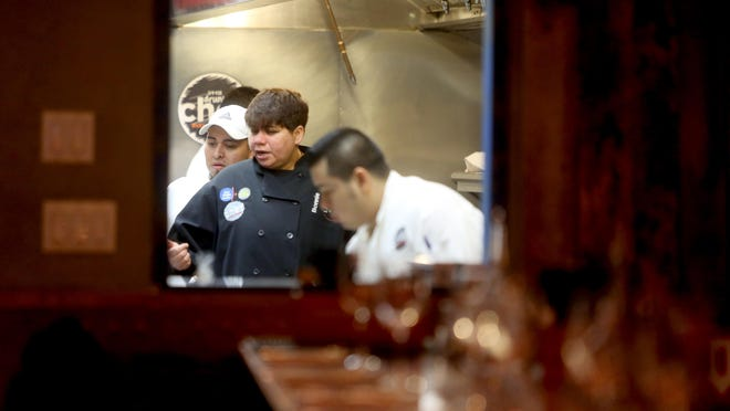 Bonnie Saran, the owner of Little Drunken Chef in Mount Kisco, works with her kitchen staff Nov. 15, 2016. Saran opens the doors to her restaurant,each year on Thanksgiving and provides a free meal to anyone who has no place else to go for the holiday.