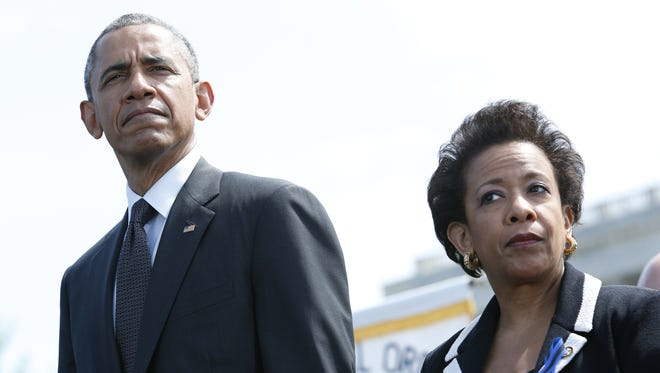 President Obama and Attorney General Loretta Lynch attend the 34th Annual National Peace Officers' Memorial Service on Capitol Hill in on May 15, 2015.
