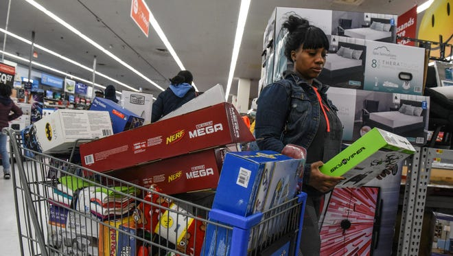 A woman shops at Walmart near the Green Acres Mall on Black Friday in Valley Stream, NY, Nov 24, 2017.