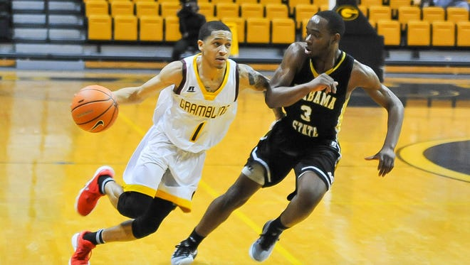 Grambling State point guard Ivy Smith Jr. (1) and the Tigers were eliminated Friday.