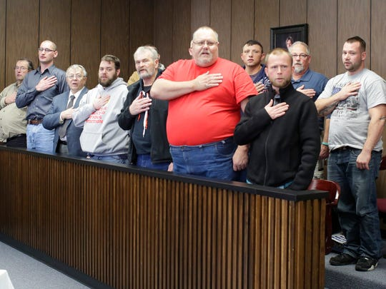 Mentors and veterans being helped by  Veterans Court recite the pledge of allegiance Nov. 20, 2015 at the Sheboygan County Courthouse in Sheboygan.