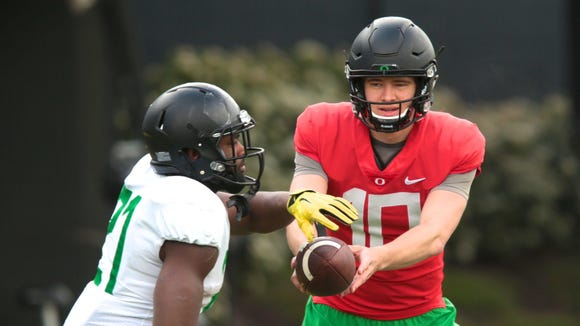 Apr 21, 2017; Eugene, OR, USA; Oregon Ducks quarterback Justin Herbert (10) hands the ball off to running back Royce Freeman (21) during spring practice at the Oregon Ducks outdoor practice facility. Mandatory Credit: Scott Olmos-USA TODAY Sports