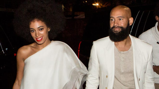 Musician Solange Knowles (wearing Stephane Rolland with Stuart Weitzman shoes and a Lee Savage clutch) and her fiancee, music video director Alan Ferguson (wearing Costume National with an H&M shirt and Maison Martin Margiela shoes), arrive for their rehearsal dinner at the Felicity Street Methodist Church on Nov. 15, 2014 in New Orleans.