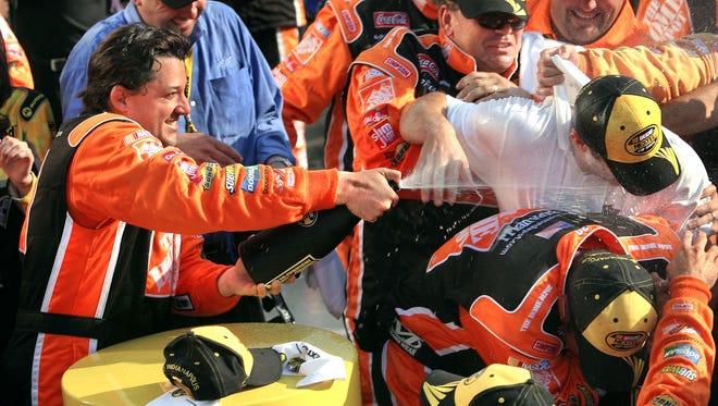 Tony Stewart sprays his crew with champagne in celebration of winning the Allstate 400 at the Brickyard at the Indianapolis Motor Speedway on Sunday, July 29, 2007. File 145084-BRICK30. (Matt Detrich / The Indianapolis Star)