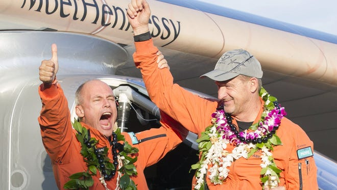 Solar Impulse 2 pilots Bertrand Piccard and Andre Borschberg, celebrate after  landing at the Kalaeloa Airport, Hawaii. The pilots landed in California on April 23, 2016, completing their round-the-world trip on the solar-powered aircraft.