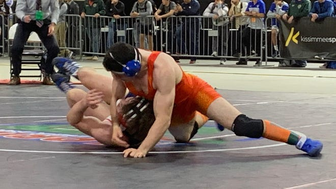 Bryan Canedo of Palm Beach Gardens makes a move on Colton Curtis of Orlando Freedom in the Class 3A championship match at 195-pounds. Canedo won 6-2 for his second consecutive state championship at the Silver Spurs Arena on Saturday.