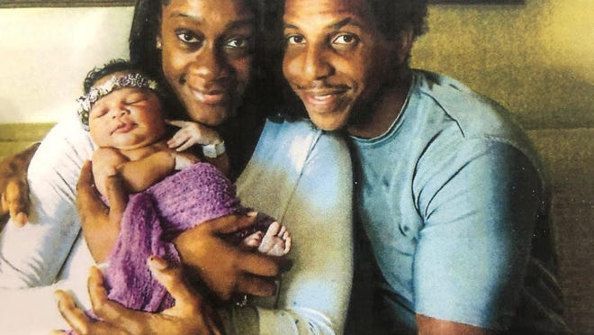 Antoinette Johnson and Darrell Jenkins with their baby, Alina Johnson. Antoinette and Alina died in a fiery crash on State Road 80 near Belle Glade in December. Jenkins is suing General Motors, the truck driver and the company where the driver worked in connection with his daughter's death.