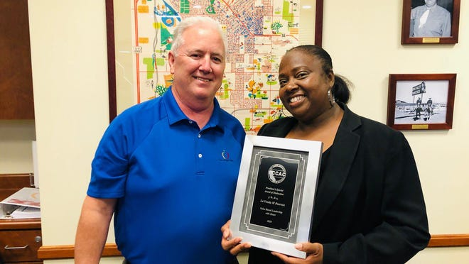 """Town of Apple Valley Director of Government Services and Town Clerk La Vonda M. Pearson with Town Manager Doug Robertson. Pearson was recently presented with the """"Value Based Leadership with Heart Award"""" by the City Clerks Association of California."""