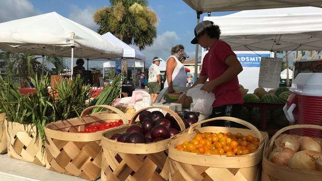 If the people exploring the vendor tents at the Carolina Beach Market on Saturday morning were worried about a hurricane, they were keeping it to themselves.