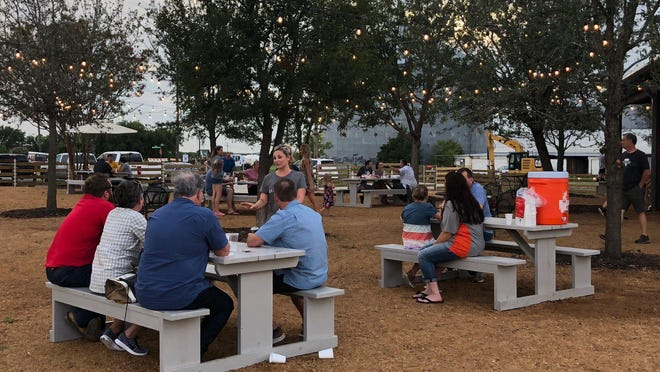 People gather in 2018 at the Silo Park food truck park in Prosper. An item to amend the property's boundaries, permitted uses and development standards was approved by the Prosper Town Council at its June 23 meeting.
