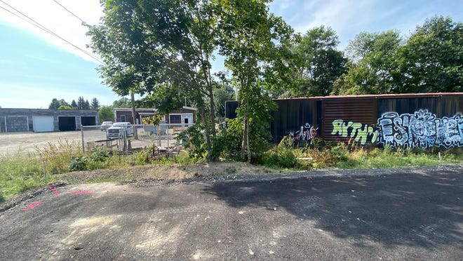 A developer wants to demolish two existing railroad related buildings and replace them with apartment buildings near the Dover Transportation Center.