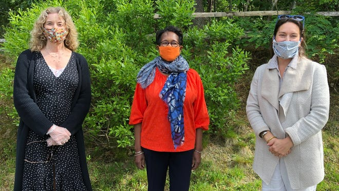 Certified life coach Edith Tonelli, left, REACH program participant Arlene Weston and Homeless Prevention Council CEO Hadley Luddy at Monday's graduation ceremony in Orleans. Weston credits the program with giving her coping skills and a way forward.