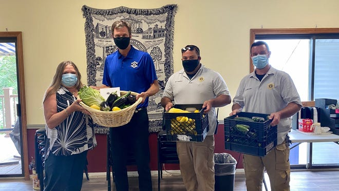 Worcester County Sheriff Lew Evangelidis and WCSO maintenance staff members Shaun Mullaney and John Travaglio deliver more than 100 pounds of freshly picked jail produce to Leominster Senior Center Director Laurane Brooks on Wednesday, July 22 for the center's elder meal program.