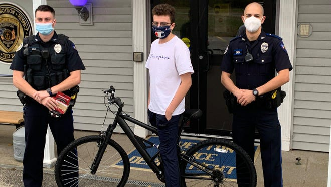 Members of the Tiverton Police Department provided a resident with a new bike after his was stolen.