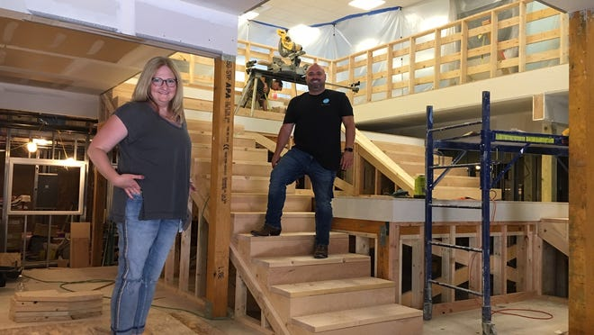 An expansion project at Map Academy will allow the charter school to reopen with plenty of room for social distancing. Co-founders Rachel Babcock and Josh Charpentier stand on what will soon be the school's new stadium-seating staircase.