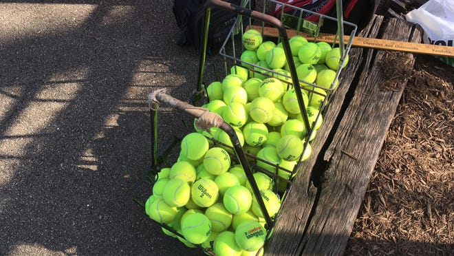These tennis balls in baskets Saturday at the John Moss Courts were used at the Dragon Invitational girls tennis tournament and will go into quarantine for about a week before becoming Pekin practice balls. That's high school tennis during a pandemic.