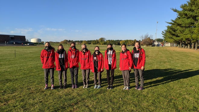 Masks on in Maxwell Park in Normal, Pekin girls cross country runners gather for a final 2020 team photo. From left are Lily Wagemann, Lauren Filarski, Olivia Wolf, Emma Cox, Elizabeth Deverman, Kylie Oyler, JayLynn Riley and Jayvian Riley.
