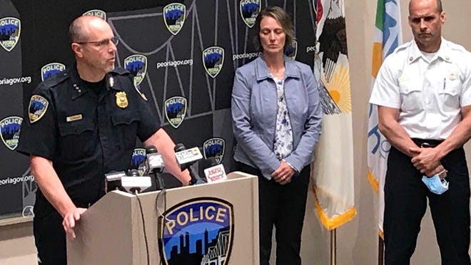 Peoria Police Chief Loren Marion, left, speaks at a press conference Monday at the police station regarding chaos and violence that rocked the city overnight. Among other leaders at the press conference were Peoria County State's Attorney Jodi Hoos, center, and Peoria Fire Chief Tony Ardis.
