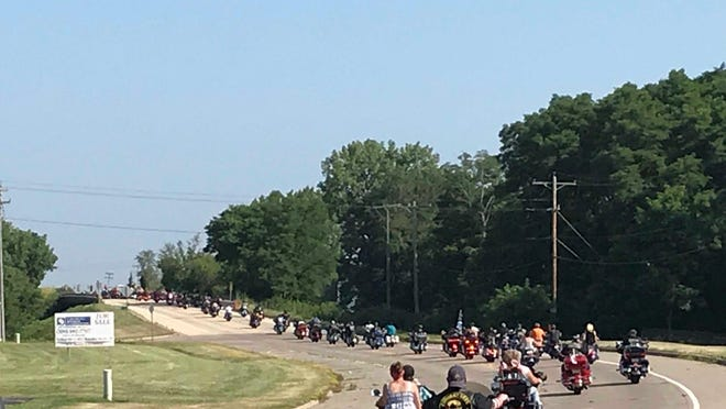 "Hundreds of motorcyclists roar from Walters Brothers Harley-Davidson, 615 S. Maxwell Road outside Peoria, in the ""Back the Blue Ride"" to support law enforcement, on Saturday, July 4, 2020."