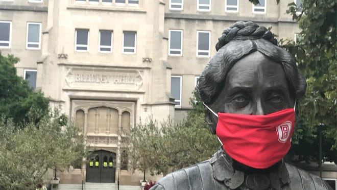 Even Lydia Moss Bradley is coronavirus cautious.The statue of the founder of Bradley University wears an official school face mask from her central spot in front of Bradley Hall on the Peoria campus.